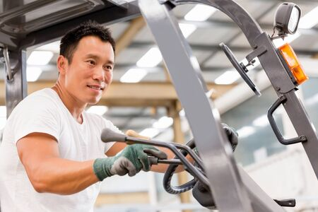portrait of asian worker in production plant working on the factory floor Stock Photo
