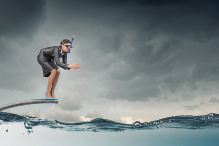 springboard: Businesswoman in suit and mask jumping from springboard