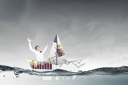 average guy: Businessman floating in boat made of paper