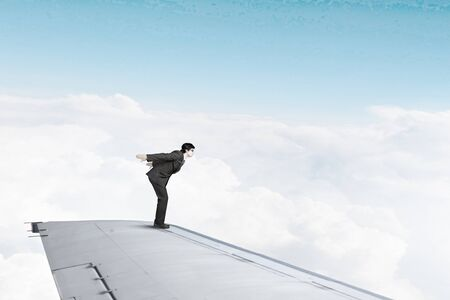 super man: Super man jumping from edge of airplane wing Stock Photo
