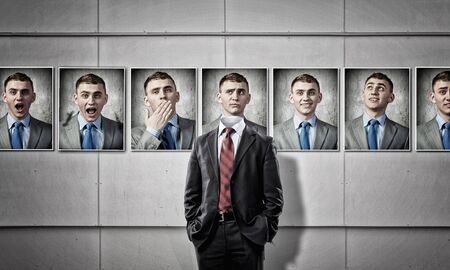 faceless: Faceless man in modern interior fitting different emotions Stock Photo