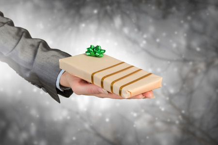 birthday suit: Close view of businesswoman hand holding gift box