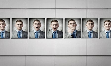 fitting in: Faceless man in modern interior fitting different emotions Stock Photo