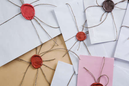 Old post concept with envelopes with wax seal on wooden surface