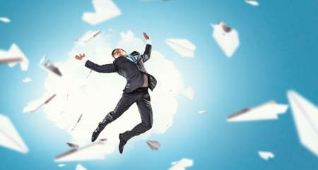 Funny jumping businessman and paper planes flying around