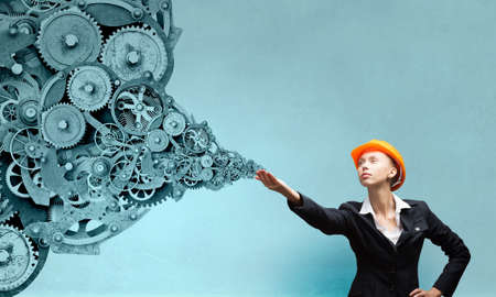 reaching hand: Attractive woman engineer reaching hand in gesture
