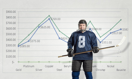 dynamic growth: Ice hockey player and graphs at background