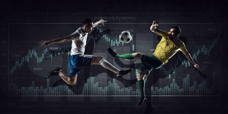 dynamic growth: Football players fighting for ball and progress infographs at background Stock Photo
