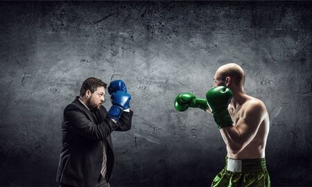 opponent: Businessman in suit fighting opponent in concrete room