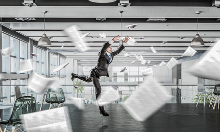 jumping businessman: Funny jumping businessman in modern 3D rendering interior. Mixed media Stock Photo