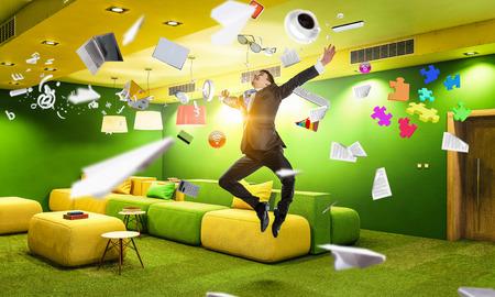 Funny jumping businessman in modern 3D rendering interior. Mixed media Reklamní fotografie