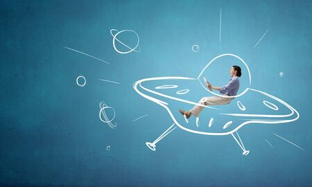 funny image: Funny image of woman flying in drawn spaceship