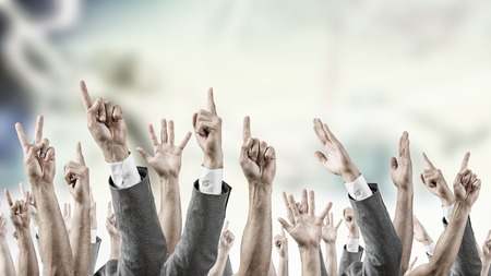 Group of people with hands up showing gestures