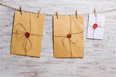 instant film transfer: Old envelopes hanging on rope fixed with clothes peg