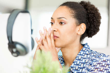 afroamerican: Portrait of beautiful tired afro-american office worker sitting in office