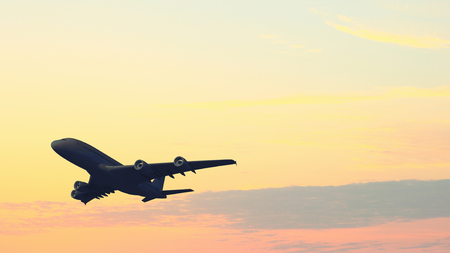 Airplane flying over blue sky at sunset