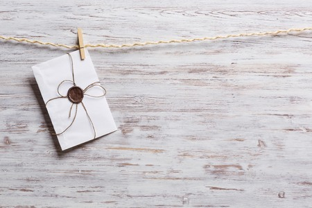 peg: Old envelopes hanging on rope fixed with clothes peg