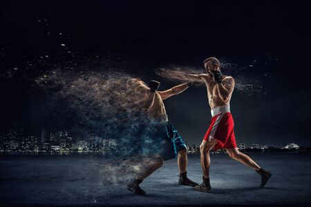 ultimate: Two strong fighters outdoor demonstrating ultimate fighting
