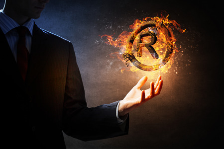 male palm: Glowing fire copyright sign in male palm Stock Photo