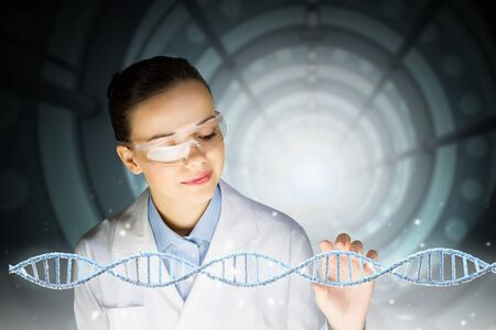 nucleotides: Woman scientist and 3D rendering DNA molecule image at media screen Stock Photo