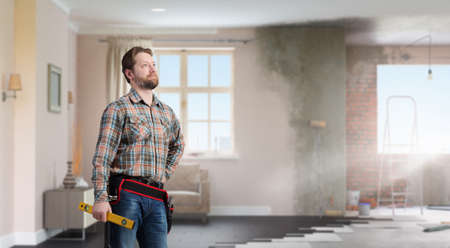 journeyman: Builder man in checked shirt with tool belt on waist. Mixed media