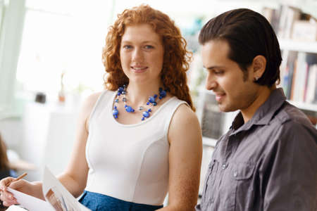 corporate women: Two young people in office in casual clothes Stock Photo