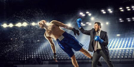 opponent: Businessman in suit fighting opponent at ring