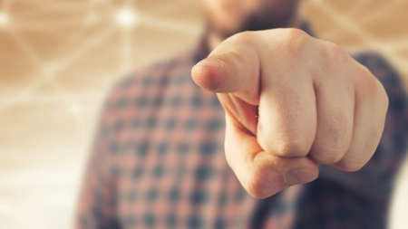 Close view of man in casual pointing with finger to camera