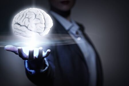 holding close: Close view of businesswoman holding in palm human brain
