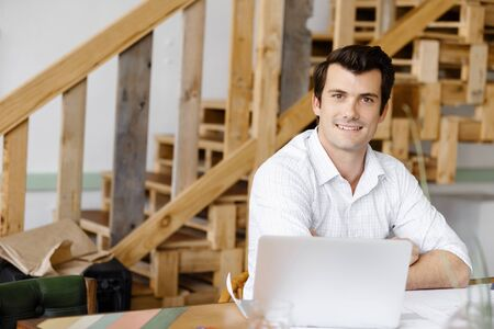 working office: Young businessman working in office