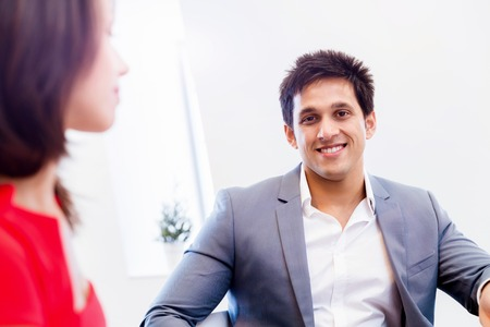 businessgroup: Two young business collegue talking in office