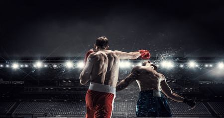 Two professional boxers are fighting on arena panorama view Stock Photo