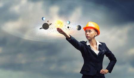 woman engineer: Attractive woman engineer reaching hand in gesture