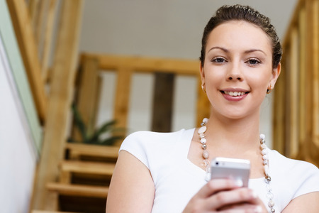 hear business call: Young woman in casual clothes in an office with mobile phone