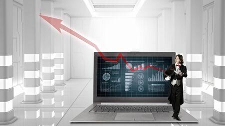 futuristic interior: Magician and big laptop in futuristic interior. Mixed media Stock Photo