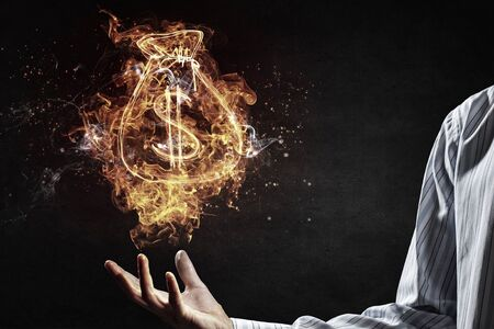 male palm: Dollar symbol in fire flames in male palm
