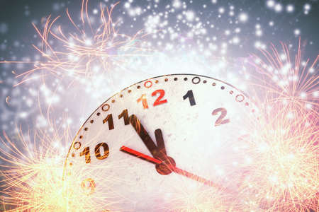12 hour: Background New Year conceptual image with clock showing five minutes to twelve