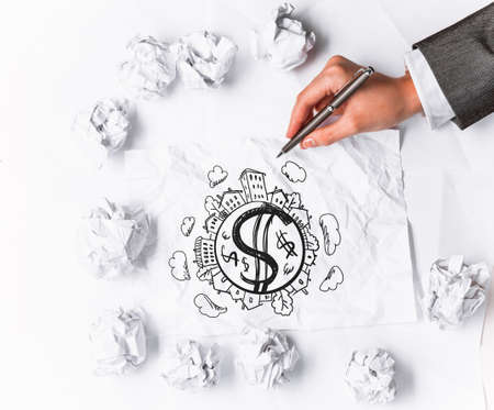 Financial growth concept with hand drawing money signs on paper sheets