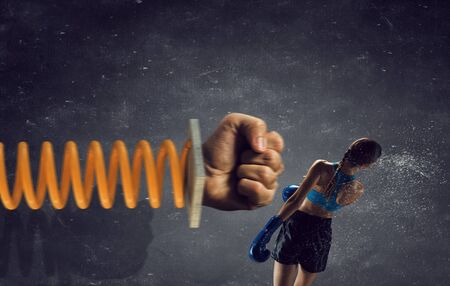attacked: Young boxer woman attacked with glove on spring Stock Photo