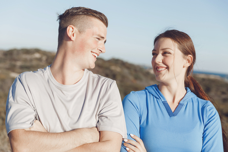 Young couple on beach wearing sportwear