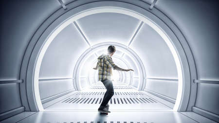 futuristic interior: Teenager guy riding skateboard on futuristic interior. Mixed media Stock Photo