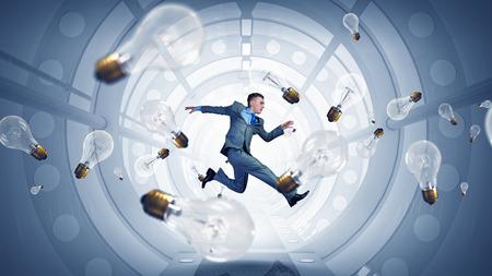 futuristic interior: Cheerful businessman in futuristic interior jumping high. Mixed media Stock Photo