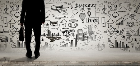 problem solution: Bottom view of businessman and business ideas sketched at background Stock Photo