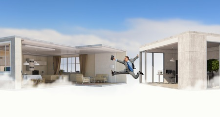 modern interiors: Young businessman jumping between two modern interiors.   . Mixed media