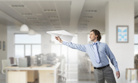 careless: Careless businessman in office playing with paper plane.   . Mixed media