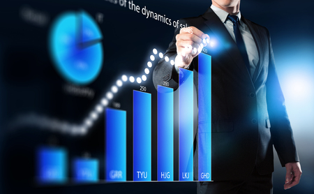 average guy: Close view of businessman drawing on screen market infographs . Mixed media