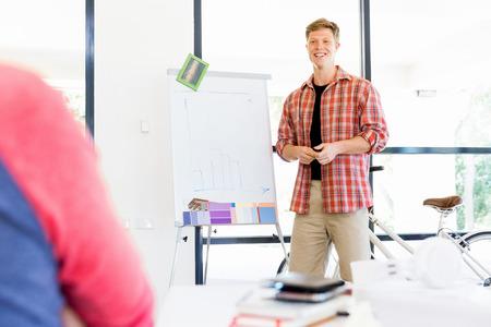 Portrait of young male businessman doing presentation Imagens