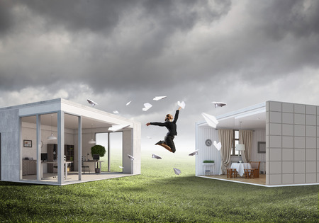modern interiors: Young businesswoman jumping between two modern interiors. Mixed media Stock Photo