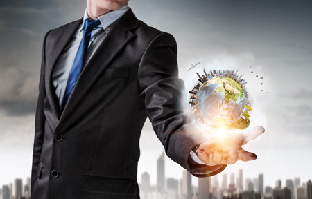 business globe: Businessman holding Earth planet in hand. Elements of this image are furnished by NASA Stock Photo