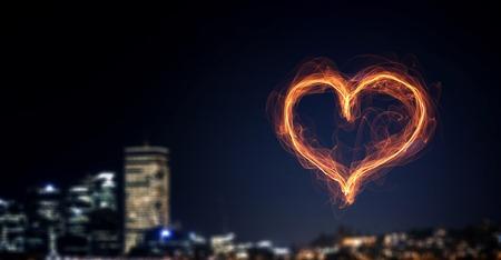 heart burn: Love heart glowing symbol on dark background